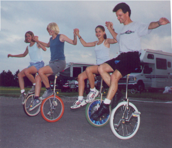 Learning to backwards wheel walk: Tanya, Tammy, and Suzanne Wrobel of RTUC, with teacher Neil Younggren of TCUC.