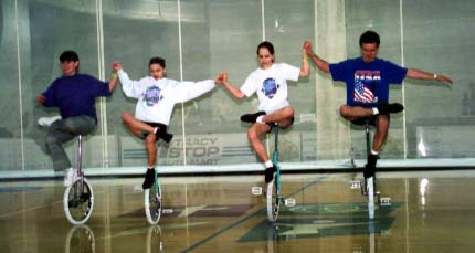 Connie, Kelsey, Christie and Neil (TCUC) demonstrate creative one-foot wheel walk.